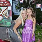 With actress Caitlin Carmichael at the film premiere of A COUNTRY CHRISTMAS at the DeMille Theatre at Culver Studios.
