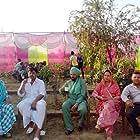 Om Puri, Daljit Kaur, Guggu Gill, and Sardar Sohi in Jatt Boys Putt Jattan De (2013)