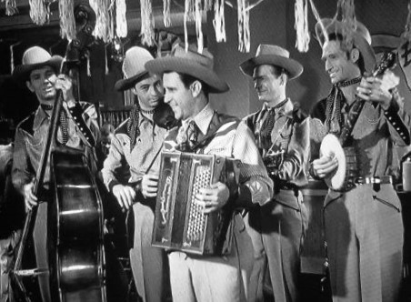 Pee Wee King and Golden West Cowboys in Flame of the West (1945)