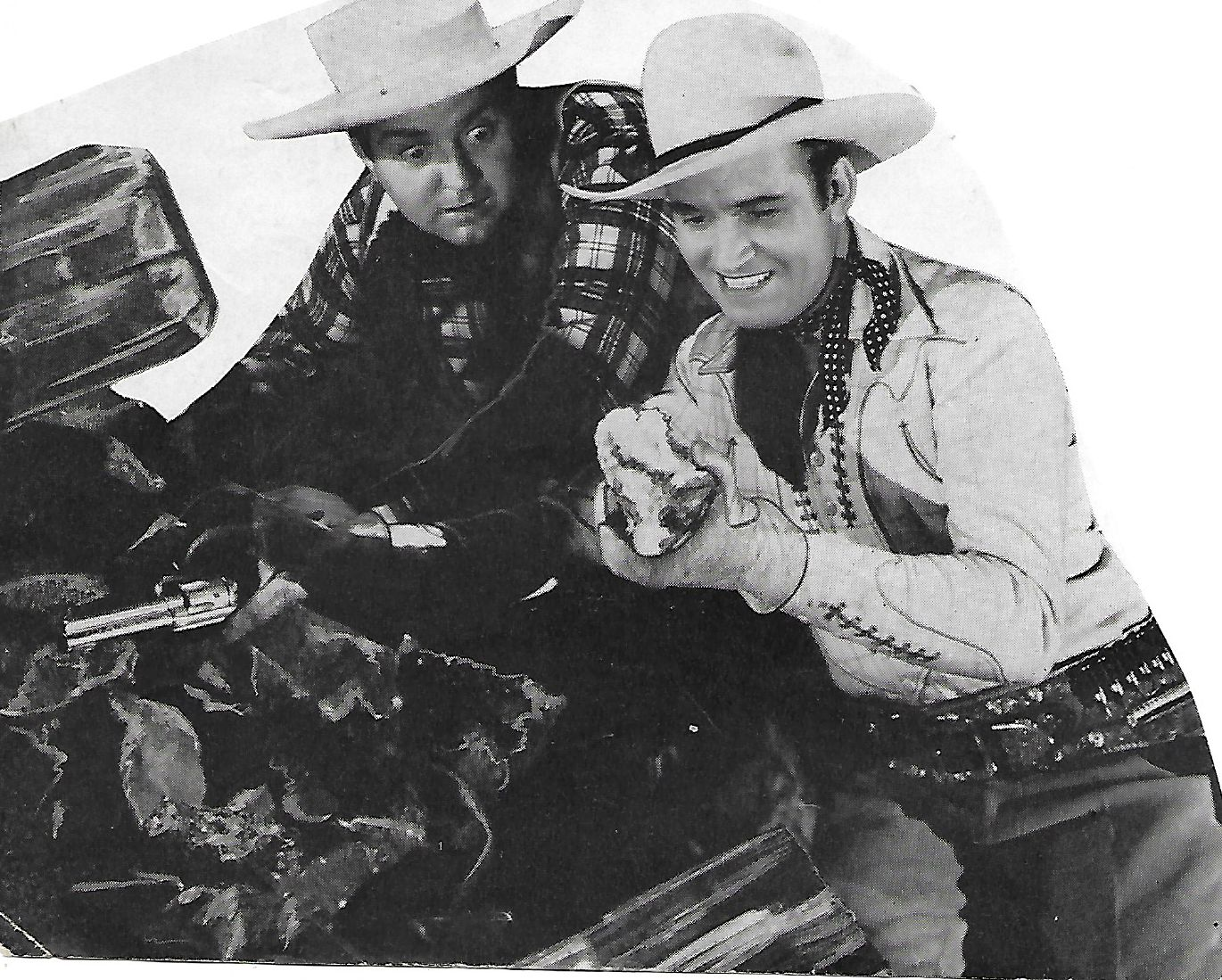 Gene Autry and Smiley Burnette in Man from Music Mountain (1938)