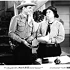 Smiley Burnette and Charles Starrett in Trail of the Rustlers (1950)