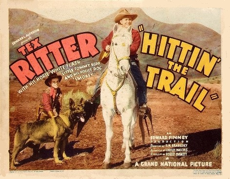 Tommy Bupp, Tex Ritter, White Flash, and Smokey the Dog in Hittin' the Trail (1937)