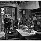 Leopold Biberti, Zarli Carigiet, Emil Hegetschweiler, and Fred Tanner in Der Schuß von der Kanzel (1942)