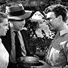 Humphrey Bogart, Eddie Albert, and Joan Leslie in The Wagons Roll at Night (1941)