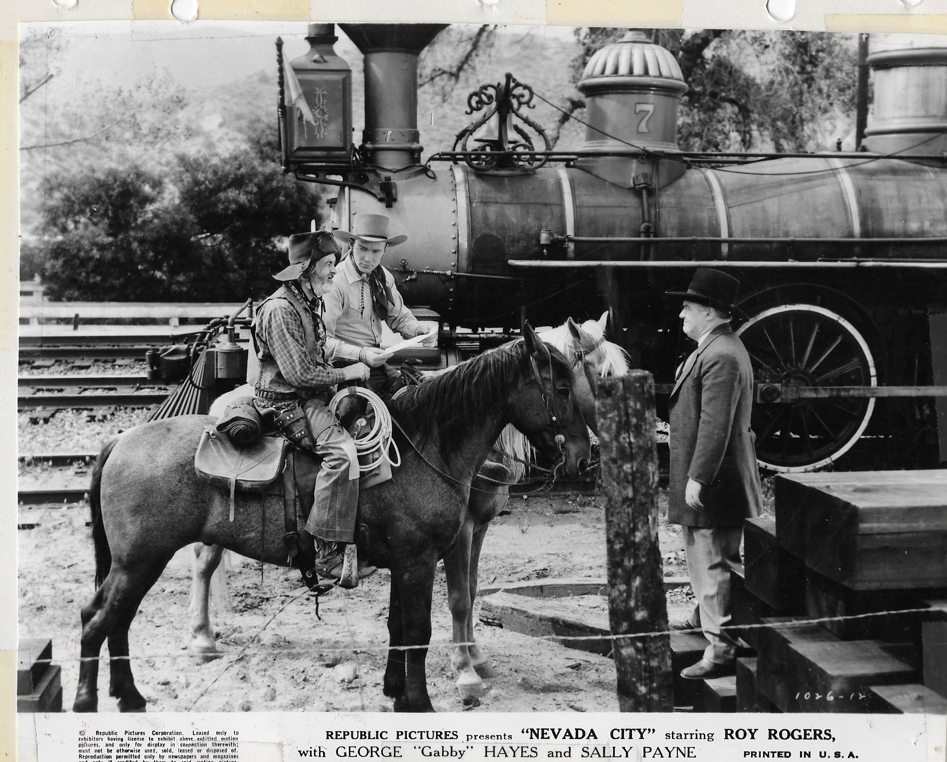 Roy Rogers, Joseph Crehan, George 'Gabby' Hayes, and Trigger in Nevada City (1941)