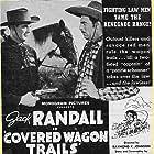 Jack Randall and Glenn Strange in Covered Wagon Trails (1940)