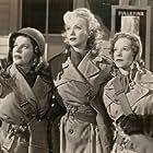 Carole Landis, Mitzi Mayfair, and Martha Raye in Four Jills in a Jeep (1944)