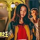 Xingzhe Yuan, Qi Zhang, and Jingwen E. in The New King of Comedy (2019)