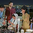 Mehdi Hosseini, Mahtab Amin, Ramin Pourabdollah, Reyhaneh Esmaeilyan, and Mina Vahid in Kermchaleh (2019)