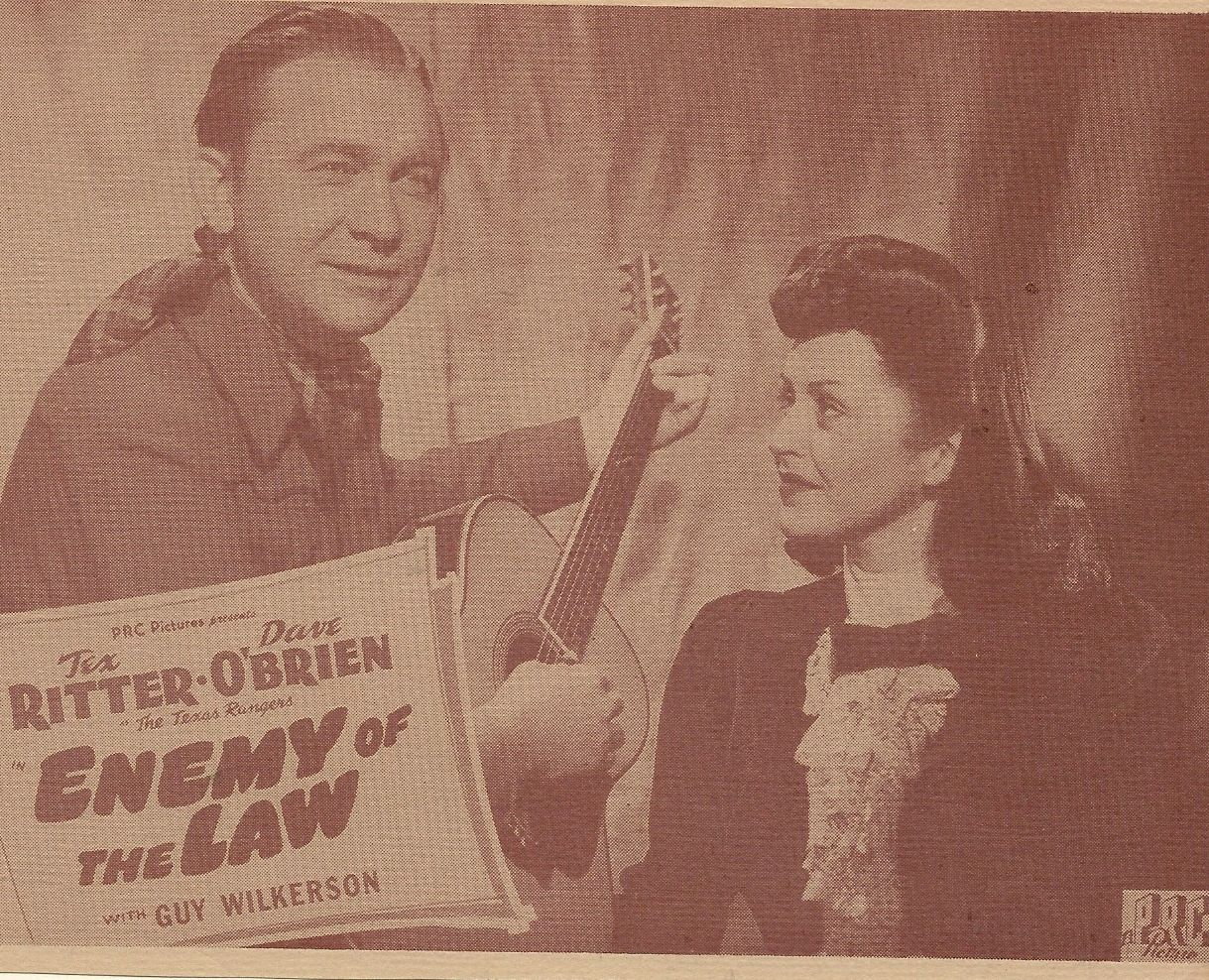 Kay Hughes and Tex Ritter in Enemy of the Law (1945)
