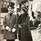 Charles Chaplin and Alice Davenport in Making a Living (1914)