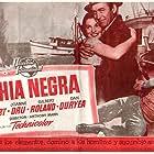 James Stewart, Dan Duryea, and Joanne Dru in Thunder Bay (1953)