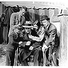 John Wayne, James Bradbury Jr., Dorothy Gulliver, Edward Hearn, and 'Little Billy' Rhodes in The Shadow of the Eagle (1932)