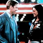 Courteney Cox and Ron Eldard in The Runner (1999)