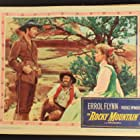Errol Flynn, Chubby Johnson, and Patrice Wymore in Rocky Mountain (1950)