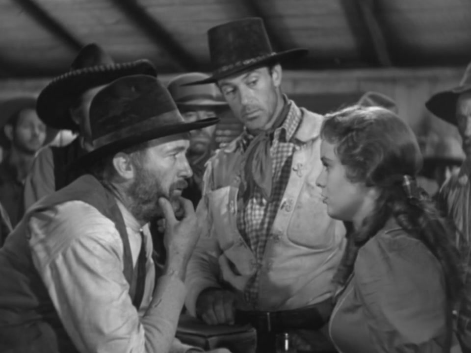 Gary Cooper, Walter Brennan, and Doris Davenport in The Westerner (1940)