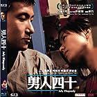 Jacky Cheung and Karena Kar-Yan Lam in Nam yan sei sap (2002)