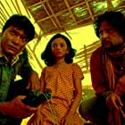 Aditya Srivastav, Raj Arjun, and Swini Khara in Kaalo (2010)
