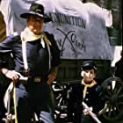 "John Wayne and his son, Ethan, on location for ""Rio Lobo,"" Cinema Center 1970."