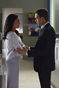Patrick J. Adams and Meghan Markle in Suits (2011)