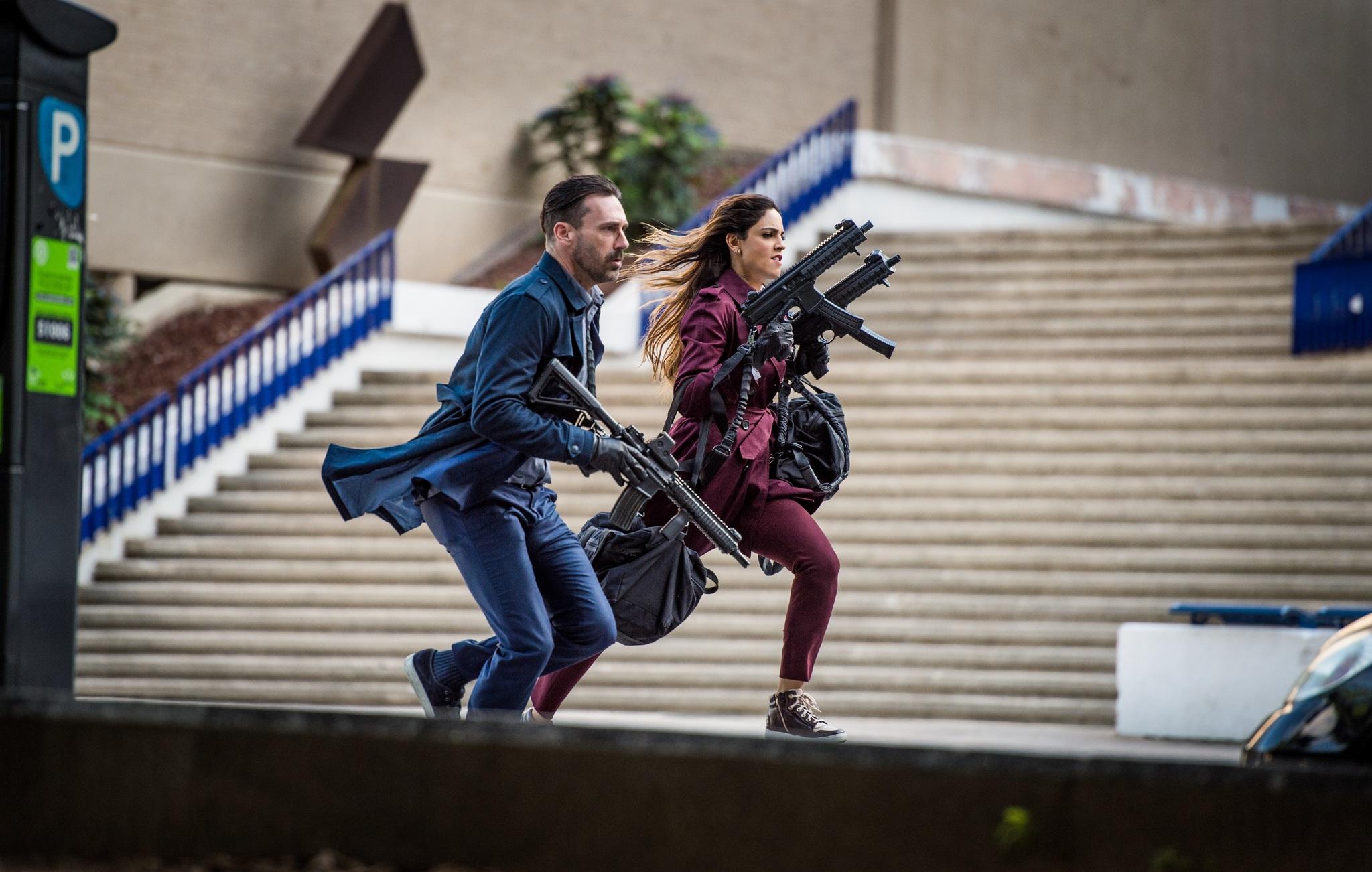 Jon Hamm and Eiza González in Baby Driver (2017)