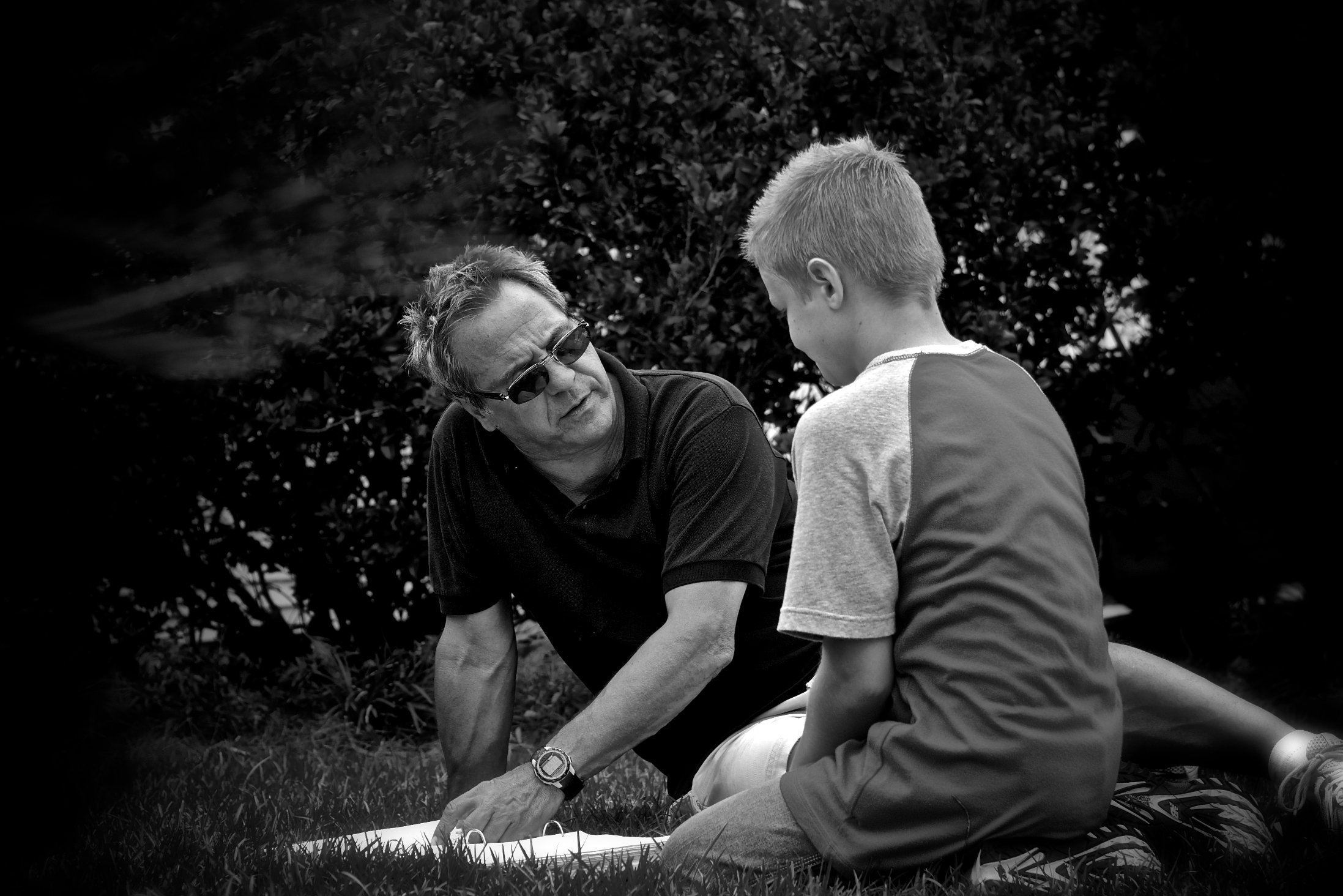 Between scenes, director David Anspaugh confers with Chandler Canterbury, regarding the young actor's lead role as Zach Bonner.