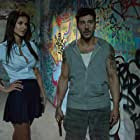 David Belle and Catalina Denis in Brick Mansions (2014)
