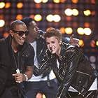 Ludacris and Justin Bieber in Justin Bieber: All Around the World (2012)