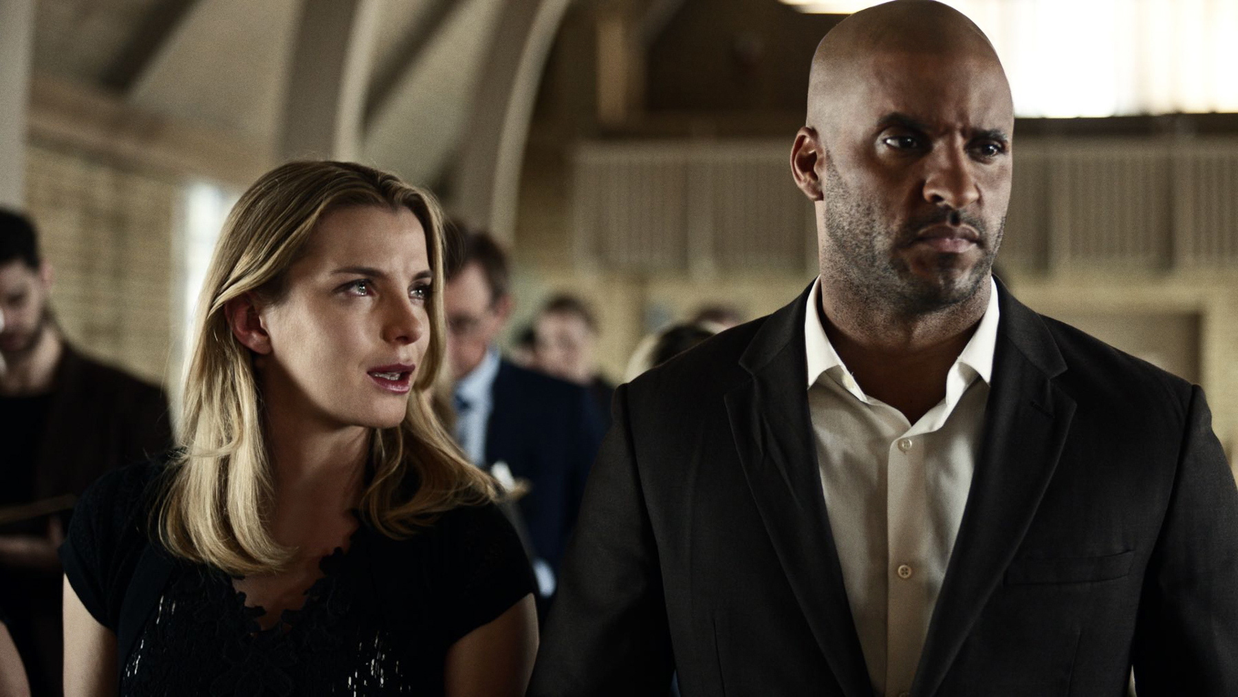Ricky Whittle and Betty Gilpin in American Gods (2017)