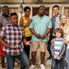 Tichina Arnold, Cedric the Entertainer, Max Greenfield, Sheaun McKinney, Beth Behrs, Marcel Spears, and Hank Greenspan in The Neighborhood (2018)