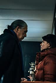 Devery Jacobs and Jacques Newashish in Bootlegger