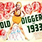 Joan Blondell, Ginger Rogers, Ruby Keeler, Guy Kibbee, Aline MacMahon, Dick Powell, Ned Sparks, Warren William, and Millie Walters in Gold Diggers of 1933 (1933)