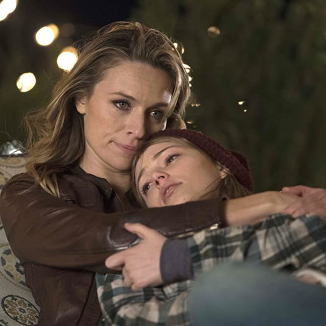 Grace Van Dien and Michaela McManus in The Village (2019)