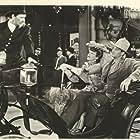 John Wayne, Hank Bell, and Ann Dvorak in Flame of Barbary Coast (1945)