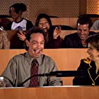 Michael McGee (front left) and Gloria Allred (front right) in a scene from ' The Rat Thing' (2007)