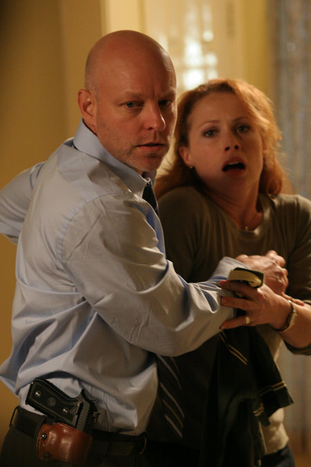 Detective Paul Grunning (James Macdonald) protects his wife (Scarlett McAlister).