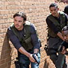 Casey Affleck, E. Roger Mitchell, Anthony Mackie, and Ian Casselberry in Triple 9 (2016)