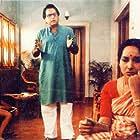 Dipankar Dey, Mamata Shankar, and Bikram Bhattacharya in Agantuk (1991)