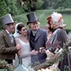 Anne Hathaway, Tom Courtenay, Barry Humphries, and Charlie Hunnam in Nicholas Nickleby (2002)