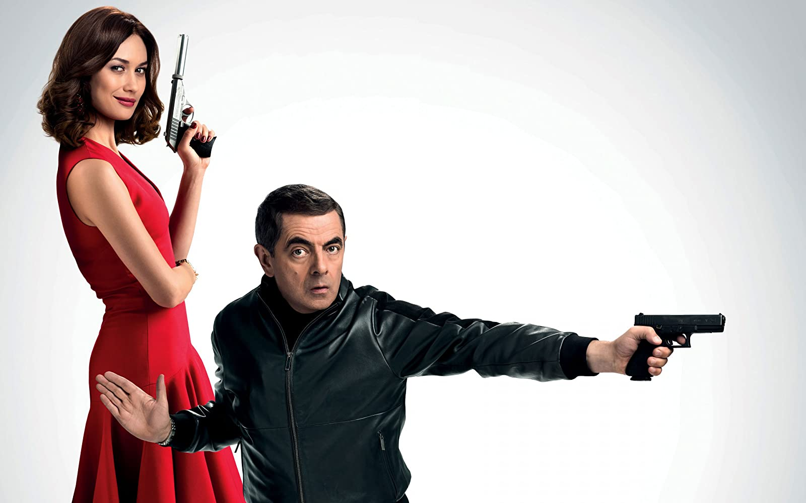Rowan Atkinson and Olga Kurylenko in Johnny English Strikes Again (2018)
