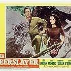 Lex Barker and Rita Moreno in The Deerslayer (1957)