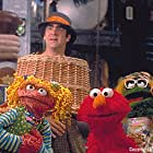 Elmo and assorted grouches with Huxley