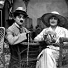 Charles Chaplin and Edna Purviance in The Cure (1917)