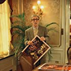 Director Val Waxman (WOODY ALLEN) has a hard time envisioning poster ideas for his latest movie in Woody Allen's contemporary comedy HOLLYWOOD ENDING, being distributed domestically by DreamWorks.