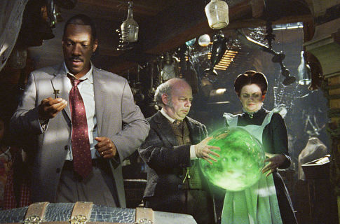 Jennifer Tilly, Eddie Murphy, Wallace Shawn, and Dina Spybey-Waters in The Haunted Mansion (2003)