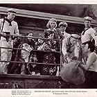 Louis Adlon, Edwin Brian, Darryl Hickman, Carole Landis, Onslow Stevens, and Roland Varno in Mystery Sea Raider (1940)