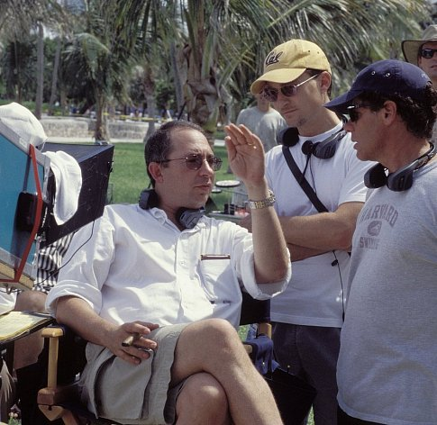 Sonnenfeld (left) discusses a scene on set with producer Barry Josephson (center).