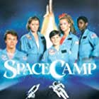 Kelly Preston, Lea Thompson, Joaquin Phoenix, Tate Donovan, and Larry B. Scott in SpaceCamp (1986)