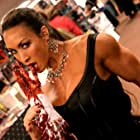 """Still photography of """"Blood + Kisses"""" promotion at the """"Fangoria Weekend of Horrors."""" Denise Masino takes a bite out of the competition."""