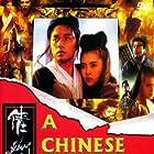 Leslie Cheung and Joey Wang in Sien lui yau wan II: Yan gaan dou (1990)